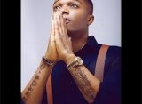 Wizkid showers encomium on his parents [PHOTO]