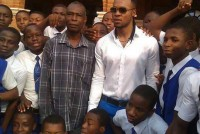 Flavour visits his alma mater, rocks school uniform [PHOTOS]