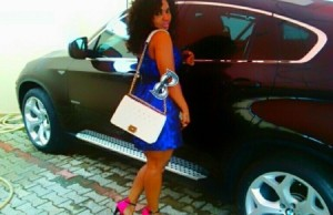 halima-poses-with-a-bmw-car-recently